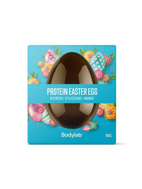 Bodylab čokoladno beljakovinsko jajce v modri škatlici.