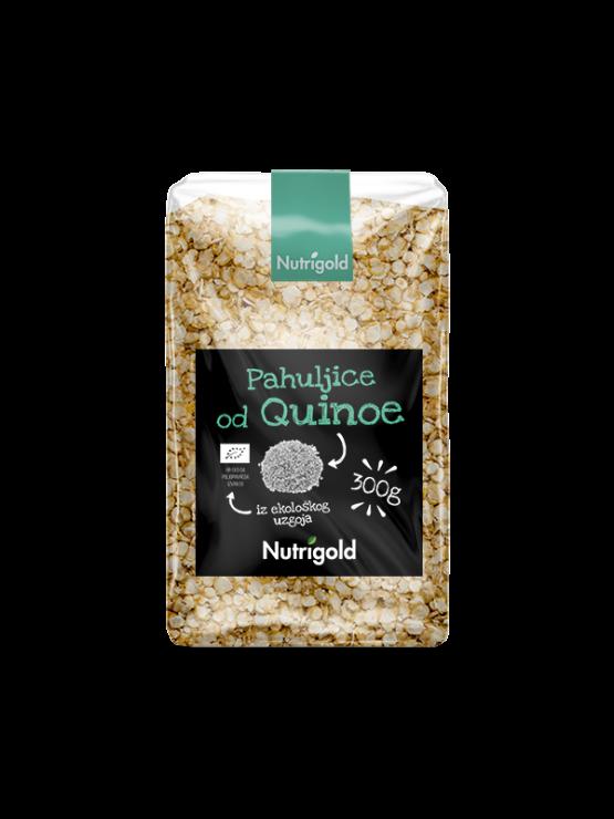 Nutrigold ekološki kvinojini kosmiči v prozorni plastični embalaži.